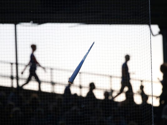 Chicago Cubs' Kris Bryant's bat is lodged in the protective netting after Bryant broke it on a pitch from Cincinnati Reds starting pitcher Scott Feldman during the first inning of a baseball game Wednesday, May 17, 2017, in Chicago. (AP Photo/Charles Rex Arbogast)