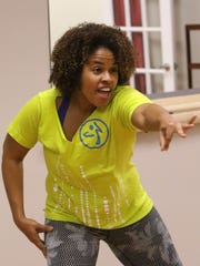 Jenel Cobb, Zumba instructor, with a class at Plainfield-based Family And Community Engagement Corp, or FACE Corp., on April 11.