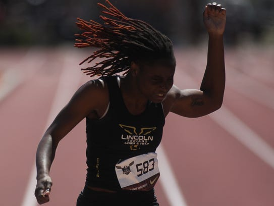 Lincoln's Jacquevia Jones finishes the 100m dash at