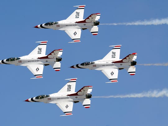 "The U.S. Air Force Thunderbirds perform the ""Diamond pass and review"" at Travis AFB, California on July 30, 2011.   (U.S. Air Force photo/Staff Sgt Richard Rose Jr.)"
