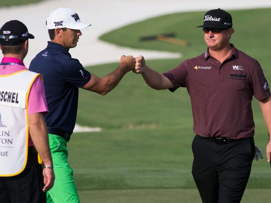 Teammates Billy Horschel, left, and Charley Hoffman bump fists during the final round of the Franklin Templeton Shootout at Tibur—n Golf Club at The Ritz-Carlton Golf Resort Saturday, Dec. 10, 2016 in Naples. The duo would finish in third place with a score of 26-under par.