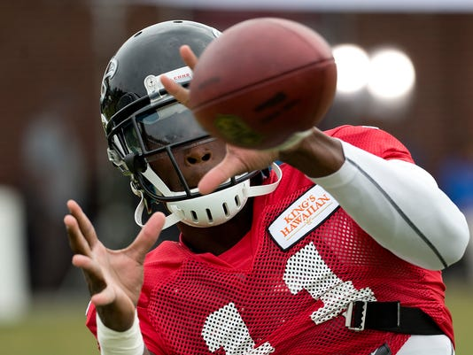 Atlanta Falcons wide receiver Julio Jones (11) makes a catch during an NFL football training camp practice in Flowery Branch, Ga., Thursday, July 31 2014. Jones is on the field and practicing with the Falcons but he's still mindful of the second screw that a surgeon placed in his right foot last fall. It's a tricky return for Jones, the former Pro Bowl selection who's trying to return to star form without suffering a setback with his right foot.  (AP Photo/John Bazemore)