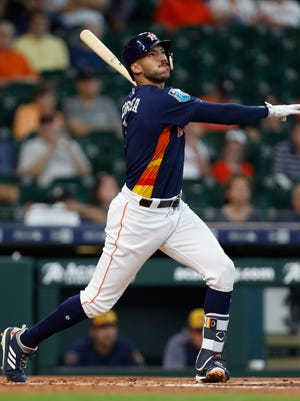 Houston's Carlos Correa watches the ball go out of the park for a grand slam against the Brewers on Tuesday.