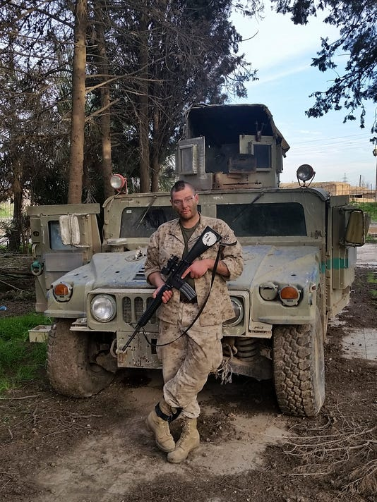 Mideast Islamic State Iraq Vets Return