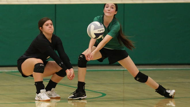 Samantha Ramsey (10) passes the ball with teammate Ivy Mead (1) during their match against Marion Thursday, Sept. 5, 2019. Marion defeated Central 27-25, 25-20, 25-23.