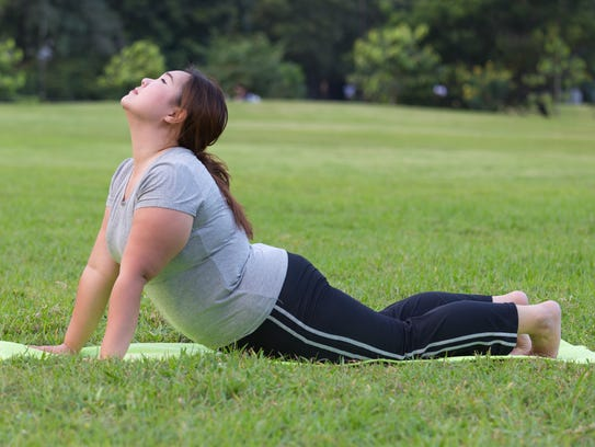 women yoga on grass