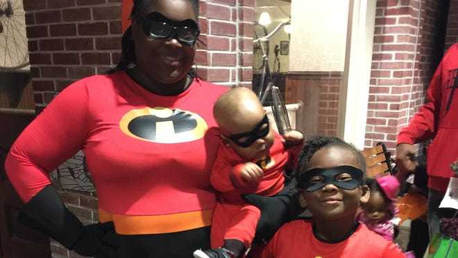 """Family members wear matching costumes at last year's """"Treats in the Streets"""" at the Detroit Historical Museum."""
