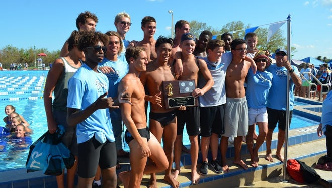 The Rockledge High boys celebrate last week's Cape Coast Conference championship.