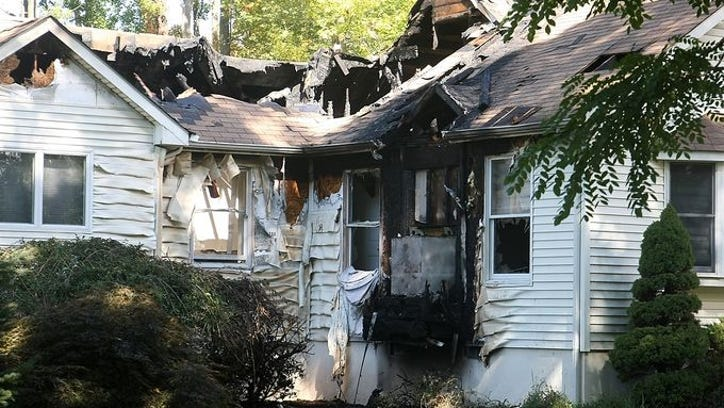 Two men have been arrested and charged in the fire that destroyed this South Brunswick house on Monday night.