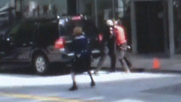 A screen capture from a video taken of an officer-involved shooting in downtown Atlanta on Wed., Aug. 27, 2014.