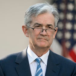 Fed raises rates, keeps forecast for 3 hikes in 2018