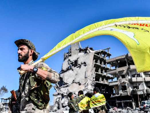 A member of the Syrian Democratic Forces (SDF), backed