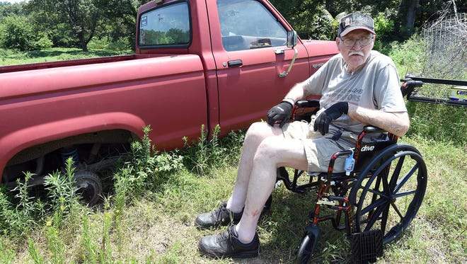 Richard Albertson, 68, of Gassville, talks Monday about a theft of tires and rims from his 1988 Ford Ranger. A $2,500 reward is being offered for information leading to a conviction in connection with the theft.