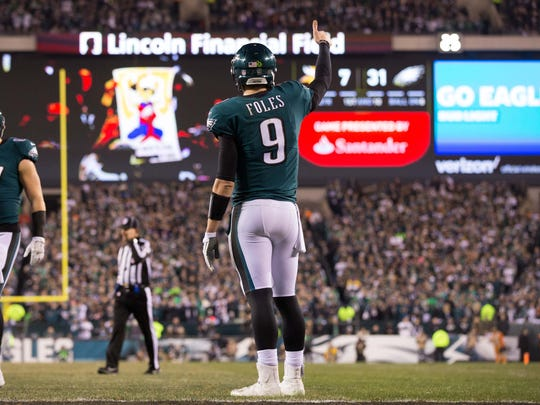 Jan 21, 2018; Philadelphia, PA, USA; Philadelphia Eagles quarterback Nick Foles (9) gives a thumbs up during a break in at the action against the Minnesota Vikings at Lincoln Financial Field.