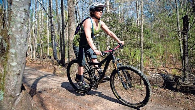 A mountain cyclist rides down a trail at the Bent Creek Experimental Forest at the tip of the Pisgah National Forest. Bent Creek is a popular mountain biking spot for its close proximity to Asheville and the wide variety of trails for beginning to advanced riders, groups and families.