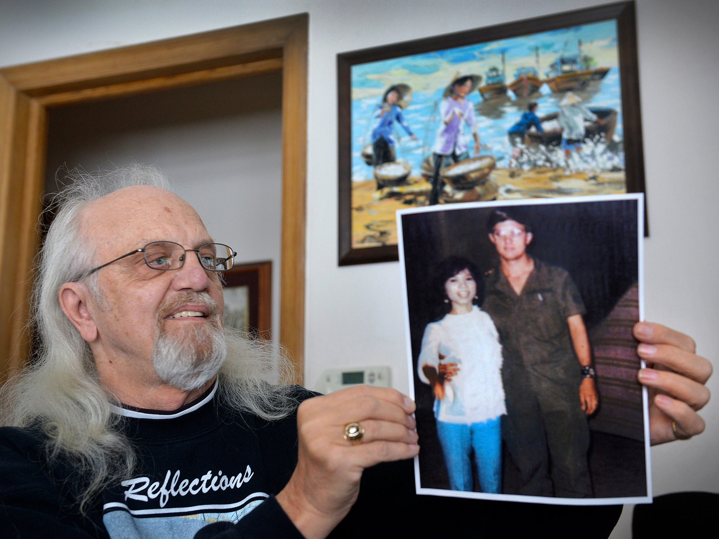 Reischl shows a photo of him with then girlfriend Kim Hoa when he was stationed in Vietnam as he talked Wednesday, Dec. 2 in his St. Cloud home.