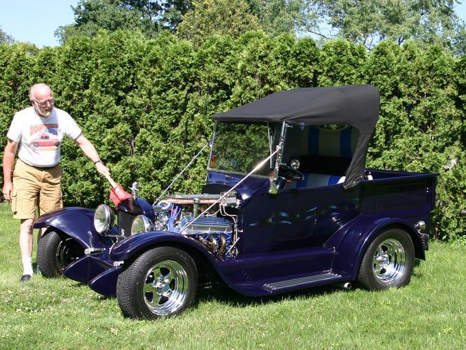 Harvey Ettinger of Farmington Hills with a 1923 Ford