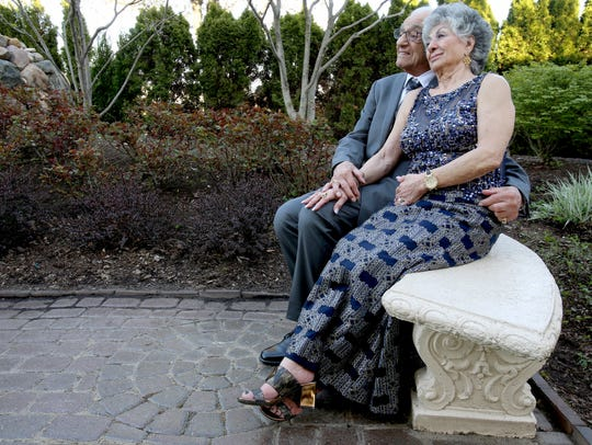 Tony George, 93, and Sophia George, 88, pose for pictures