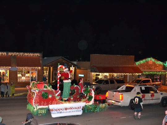 Santa Claus waves from his float at last year's Festival of Lights parade.