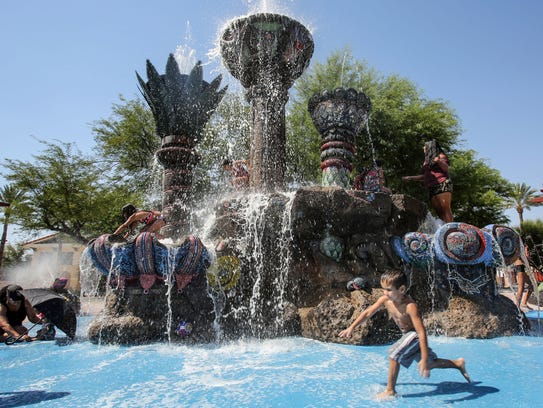 Children play at the fountain at the Cathedral City