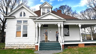 Andrew Woodfin, Program Specialist for City of Franklin Parks and Torrey Barnhill, Friends of Franklin Parks, look around the Hayes House, which will be renovated in the near future. The house is on the property of the Park at Harlinsdale Farm and was built in 1896Friday Feb. 23, 2018, in Franklin, Tenn