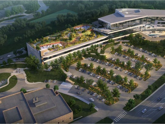 A rendering of the planned expansion of Incyte's headquarters off Augustine Cut-Off, near Alapocas, is shown. The project includes a parking garage with green roof to the left and office space in the attached building to the right.