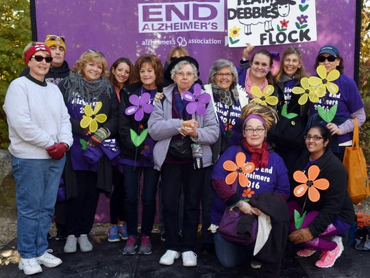 Debbie Lamb, far right standing with yellow flower,
