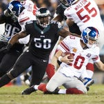 The Eagles' Trent Cole sacks Giants quarterback Eli Manning during the first half. The Eagles had five sacks in the first half and eight total against the Giants on Sunday.