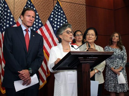 Sen. Barbara Boxer, D-Calif., speaks to reporters in defense of Planned Parenthood as Sens. Richard Blumenthal, D-Conn., left, and Mazie Hirono, D-Hawaii, right, listen Monday, Aug. 3, 2015 on Capitol Hill in Washington. The Senate blocked a Republican drive Monday to terminate federal funds for Planned Parenthood, setting the stage for the GOP to try again this fall amid higher stakes.