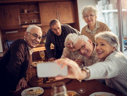 Senior adults taking a picture of themselves