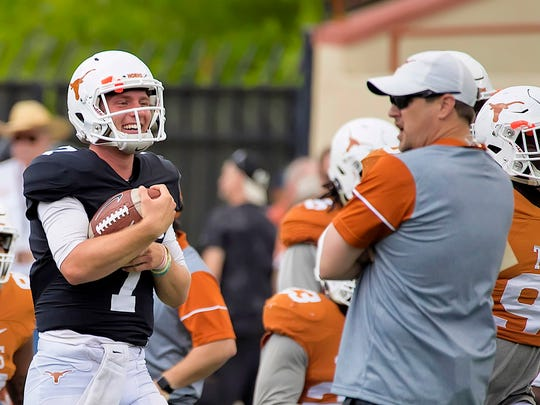 Texas quarterback Shane Buchele (7) smiles with Texas
