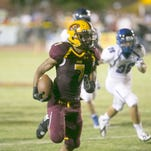 Mountain Pointe High running back Brandyn Leonard carries the ball on his way to a touchdown on the play against Chandler High during the first half at Mountain Pointe High in Phoenix on Friday, Sept. 19, 2014.