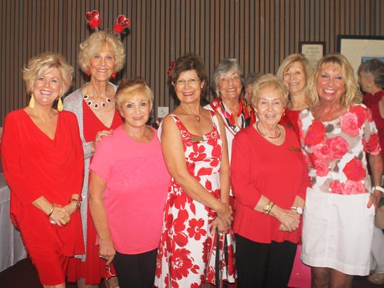 Sharon Cook, Susie Walsh, Ginny Milillo, JoAnn Brandau, Jean Davis, Diane Rowse, Betty Muskus and Jan Cirillo spead the love.