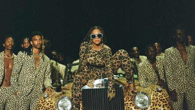 "Beyonce, center, in a scene from her visual album ""Black is King"""