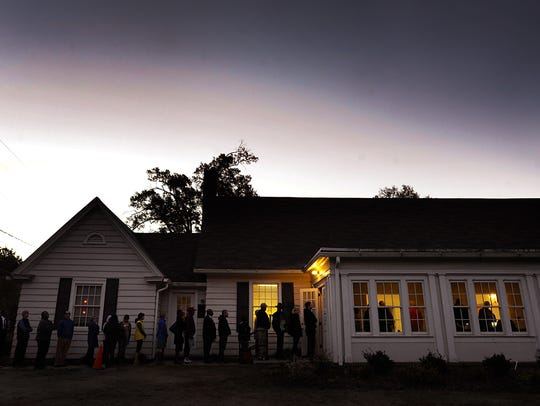 A line formed outside a voting precinct before it opened