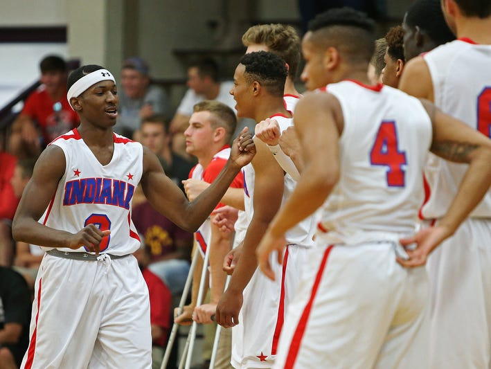 Left, Senior Eugene German (3), of Gary 21st Century, taps hands with teammates after being introduced at the Indiana boys junior All-Stars versus senior All-Stars, at Bloomington South High School, Bloomington, Ind., Tuesday, June 7, 2016. The senior All-Stars won, 118-96.