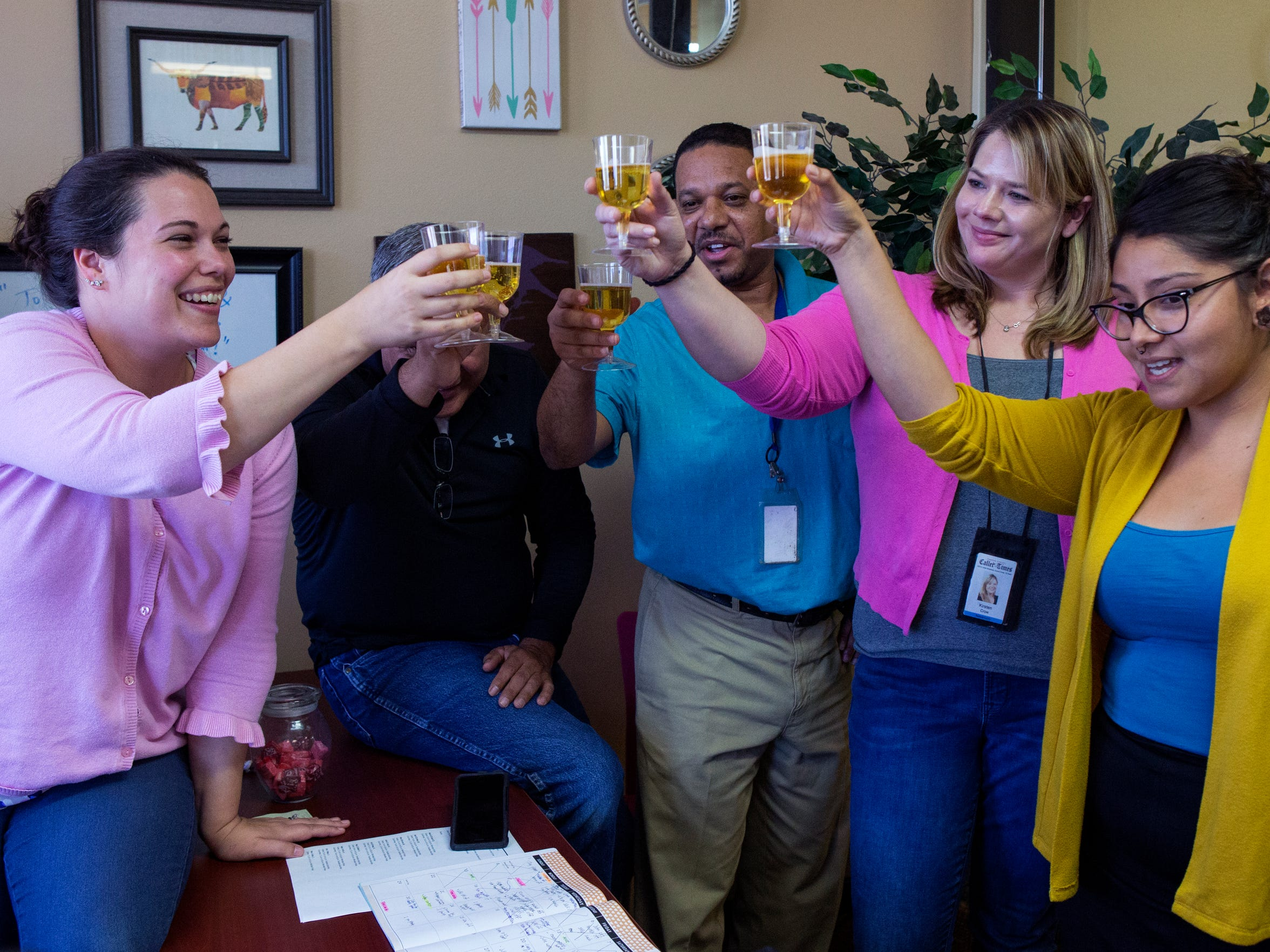 Caller-Times News Director Mary Ann Cavazos Beckett (from left), Editor Tim Archuleta, Lead Coach Chris Ramirez, and reporters Kirsten Crow and Beatriz Alvarado give a celebratory toast during a video conference call with The Arizona Republic and other USA Today Network newspapers that participated in The Wall series. The series won a Pulitzer Prize for the Republic and the network on Monday, April 16, 2018. The Caller-Times staff contributed reporting, research, photos and video and ran the series in its entirety.