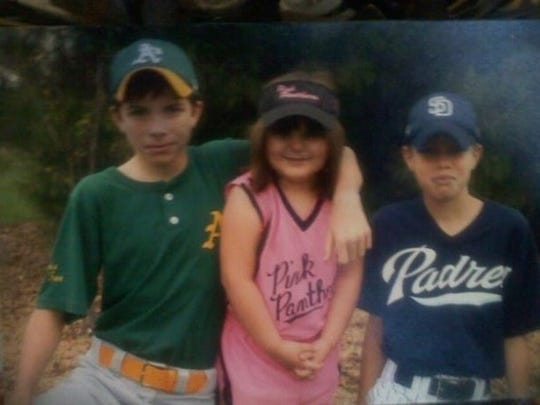 Rhonda Harrill's children, (from left) Cameron Jameson, Bevin Hill and Tanner Jameson pose for a photo about a year before Tanner's death.