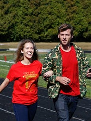 Charlie Berens walks with Lincoln's Vanessa Burger