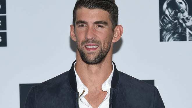 FILe - In this Aug. 28, 2016 file photo, Michael Phelps poses in the press room at the MTV Video Music Awards in New York. Phelps is participating in Discovery network's Shark Week this summer. The week of shark-themed programming in mid-summer is annually Discovery's biggest event.  (Photo by Evan Agostini/Invision/AP, File)