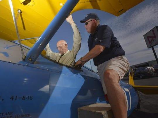 Paul McClain, 100, flew in a vintage Stearman airplane during the 2015 beach air show.