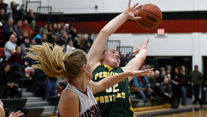 Pennfield's Alicia Lake (32) leaps for a rebound during fourth quarter of play Friday night.