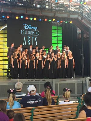 Madrigal choir and jazz band students of Snow Canyon High School perform at Disneyland.