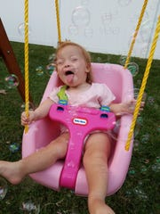 This photo of Delhi Township resident Kate White, 2, will be featured in a video of children, teens and adults with Down syndrome. The video will be shown in Times Square to help promote 2017 Down Syndrome Awareness Month.