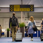 Passengers arrive at the temporary check-in area at Brussels Airport on April 4, 2016.