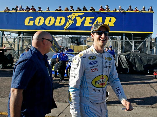 Joey Logano walks through the garage area before qualifying for Sunday's NASCAR Sprint Cup series auto race at Phoenix International Raceway, Friday, Nov. 13, 2015, in Avondale, Ariz. Logano is is looking to clinch a spot in the Chase for the Cup championship race in Homestead, Fla. (AP Photo/Ralph Freso)