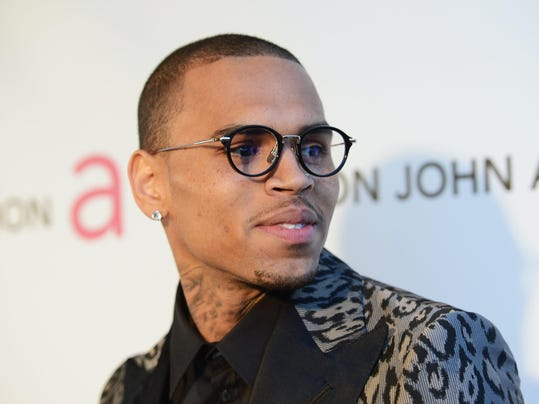 FILE: Chris Brown Investigated For Alleged Threat 21st Annual Elton John AIDS Foundation Academy Awards Viewing Party - Red Carpet