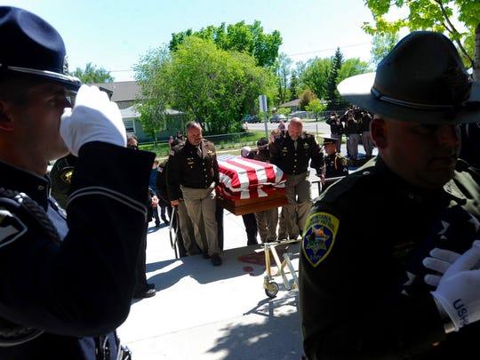 The casket carrying slain Broadwater County Deputy