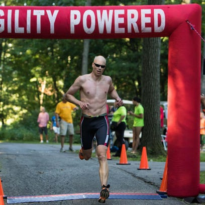 Kelly Slagh, first female overall finisher, completes with a time of 1:03:01 at the Shermanator Triathlon Saturday morning.