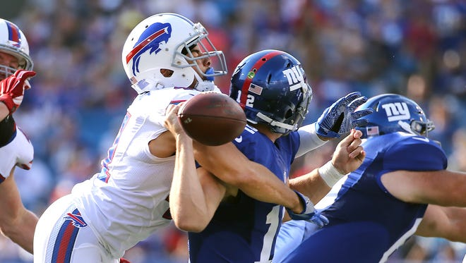 Bills Sterling Moore strips the ball from Giants quarterback Ryan Nassib on this sack.  The Bills recovered the fumble that led to a touchdown.